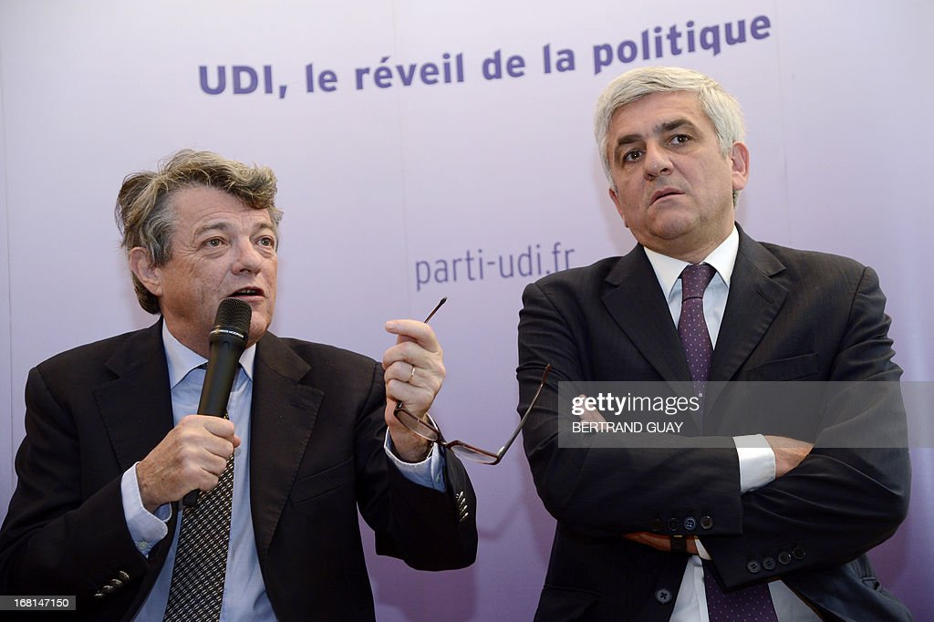 UDI center right wing French party's president Jean-Louis Borloo (L) gives a press conference flanked by his Nouveau Centre (NC) center right party's counterpart Herve Morin on May 6, 2013, focused on the first anniversary of the Francois Hollande's presidency. AFP PHOTO / BERTRAND GUAY
