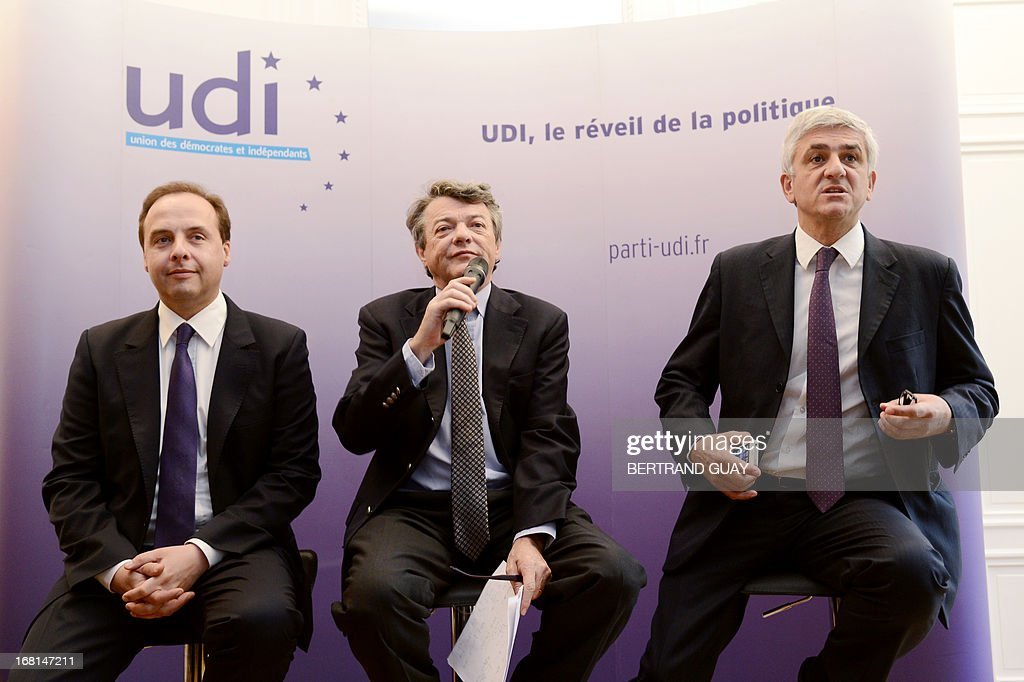 UDI center right wing French party's president Jean-Louis Borloo (C) gives a press conference flanked by his Nouveau Centre (NC) center right party's counterpart Herve Morin (R) and UDI spokesman Jean-Christophe Lagarde (L) on May 6, 2013, focused on the first anniversary of the Francois Hollande's presidency.