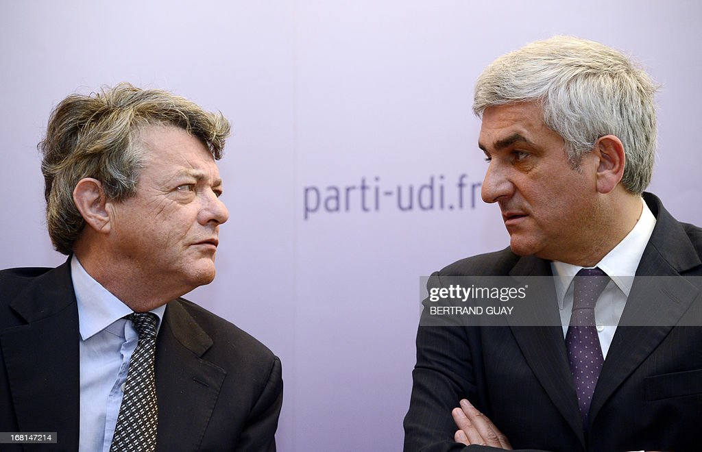 UDI center right wing French party's president Jean-Louis Borloo (L) gives a press conference flanked by his Nouveau Centre (NC) center right party's counterpart Herve Morin on May 6, 2013, focused on the first anniversary of the Francois Hollande's presidency.