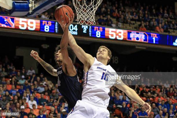 Center Robin Jorch of the Boise State Broncos and guard Jalen Moore of the Utah State Aggies go after a rebound during second half action on February...
