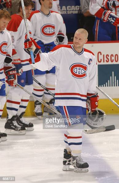 Center Saku Koivu of the Montreal Canadiens waives to the crowd before the start of the game against the Ottawa Senators at Molson Centre in Montreal...