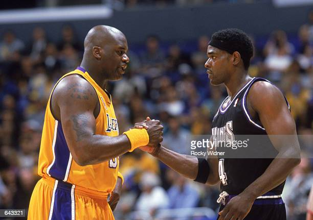 Center Shaquille O'Neal of the Los Angeles Lakers greets forward Chris Webber of the Sacramento Kings during Game Three of the Western Conference...