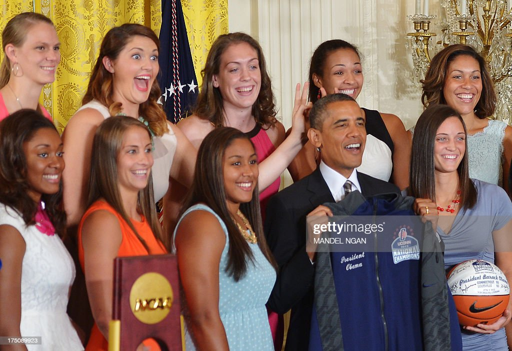 Center Stefanie Dolson (2nd L) gives the 'bunny ears' to US President Barack Obama while posing for a photo after he received a jersey and basketball from the team during an event in honour of the 2013 NCAA Womens Basketball Champions, the University of Connecticut Huskies, in the East Room of the White House on July 31, 2013 in Washington, DC. AFP PHOTO/Mandel NGAN