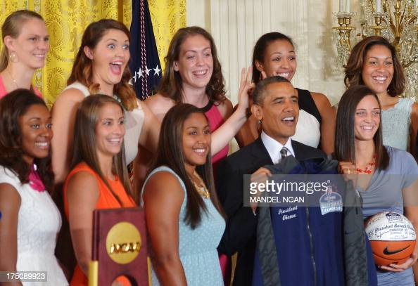 Center Stefanie Dolson gives the 'bunny ears' to US President Barack Obama while posing for a photo after he received a jersey and basketball from...