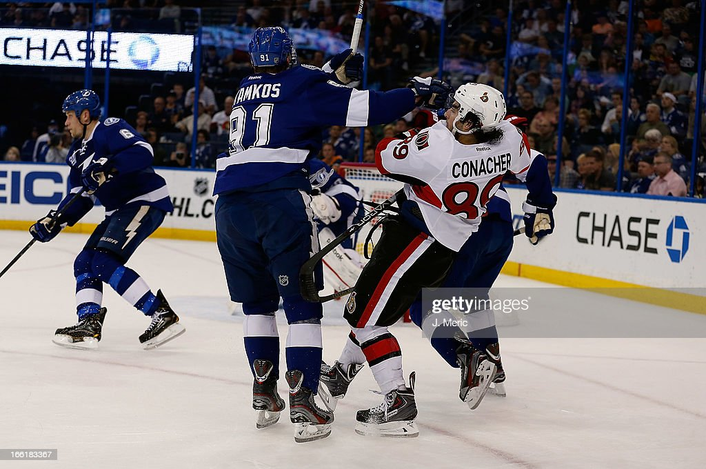 Center <a gi-track='captionPersonalityLinkClicked' href=/galleries/search?phrase=Steven+Stamkos&family=editorial&specificpeople=4047623 ng-click='$event.stopPropagation()'>Steven Stamkos</a> #91 of the Tampa Bay Lightning checks center <a gi-track='captionPersonalityLinkClicked' href=/galleries/search?phrase=Cory+Conacher&family=editorial&specificpeople=8312407 ng-click='$event.stopPropagation()'>Cory Conacher</a> #89 of the Ottawa Senators during the game at the Tampa Bay Times Forum on April 9, 2013 in Tampa, Florida.