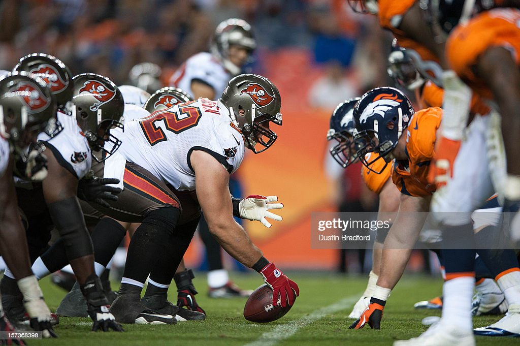Center Ted Larsen #62 of the Tampa Bay Buccaneers lines up against the Denver Broncos defense during a game at Sports Authority Field Field at Mile High on December 2, 2012 in Denver, Colorado.
