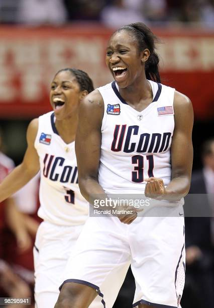 Center Tina Charles and Tiffany Hayes of the Connecticut Huskies celebrate after a 5347 win against the Stanford Cardinal during the NCAA Women's...