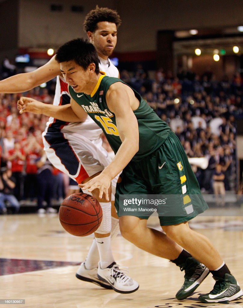 Center Xu Tao #15 of the San Francisco Dons drives the ball against forward Elias Harris #20 of the Gonzaga Bulldogs during the second half of the game at McCarthey Athletic Center on January 26, 2013 in Spokane, Washington.