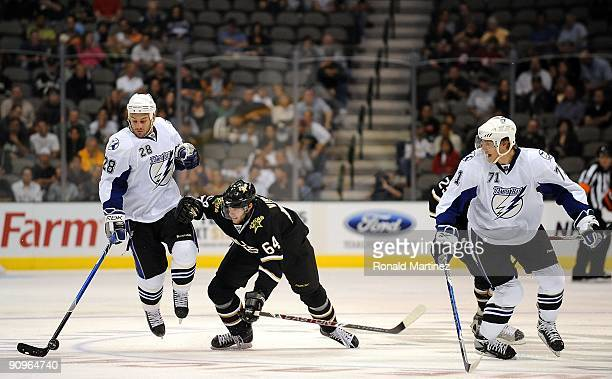 Center Zenon Konopka of the Tampa Bay Lightning skates the puck past Tomas Vincour of the Dallas Stars at American Airlines Center on September 16...
