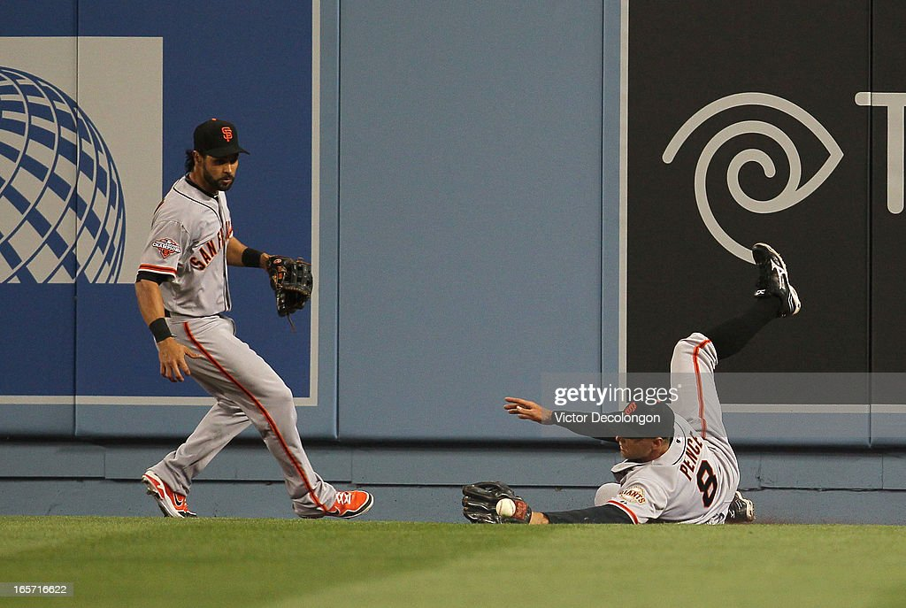 Centerfielder <a gi-track='captionPersonalityLinkClicked' href=/galleries/search?phrase=Angel+Pagan&family=editorial&specificpeople=666596 ng-click='$event.stopPropagation()'>Angel Pagan</a> #16 of the San Francisco Giants watches as teammate <a gi-track='captionPersonalityLinkClicked' href=/galleries/search?phrase=Hunter+Pence&family=editorial&specificpeople=757341 ng-click='$event.stopPropagation()'>Hunter Pence</a> #8 fails to make the catch on the flyball hit by A.J. Ellis #17 of the Los Angeles Dodgers (not in photo) to right field in the second inning during the MLB game at Dodger Stadium on April 3, 2013 in Los Angeles, California. The play resulted in a double by Ellis. The Giants defeated the Dodgers 5-3.