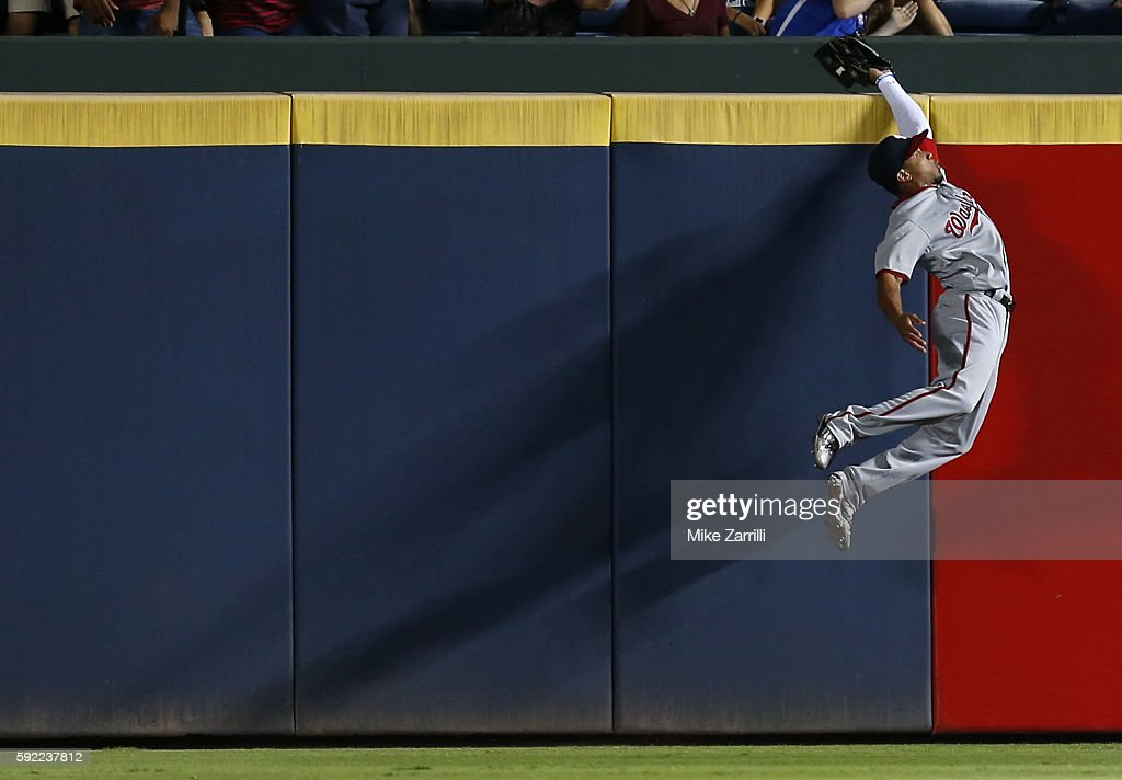 Centerfielder Ben Revere of the Washington Nationals catches a ball hit by first baseman Freddie Freeman of the Atlanta Braves to save a home run in...
