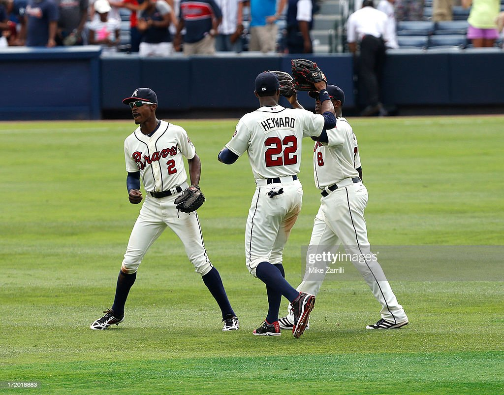 Centerfielder <a gi-track='captionPersonalityLinkClicked' href=/galleries/search?phrase=B.J.+Upton&family=editorial&specificpeople=810704 ng-click='$event.stopPropagation()'>B.J. Upton</a> #2 of the Atlanta Braves and teammates right fielder <a gi-track='captionPersonalityLinkClicked' href=/galleries/search?phrase=Jason+Heyward&family=editorial&specificpeople=5043351 ng-click='$event.stopPropagation()'>Jason Heyward</a> #22 and left fielder <a gi-track='captionPersonalityLinkClicked' href=/galleries/search?phrase=Justin+Upton&family=editorial&specificpeople=846265 ng-click='$event.stopPropagation()'>Justin Upton</a> #8 celebrate after the game against the Arizona Diamondbacks at Turner Field on June 30, 2013 in Atlanta, Georgia.