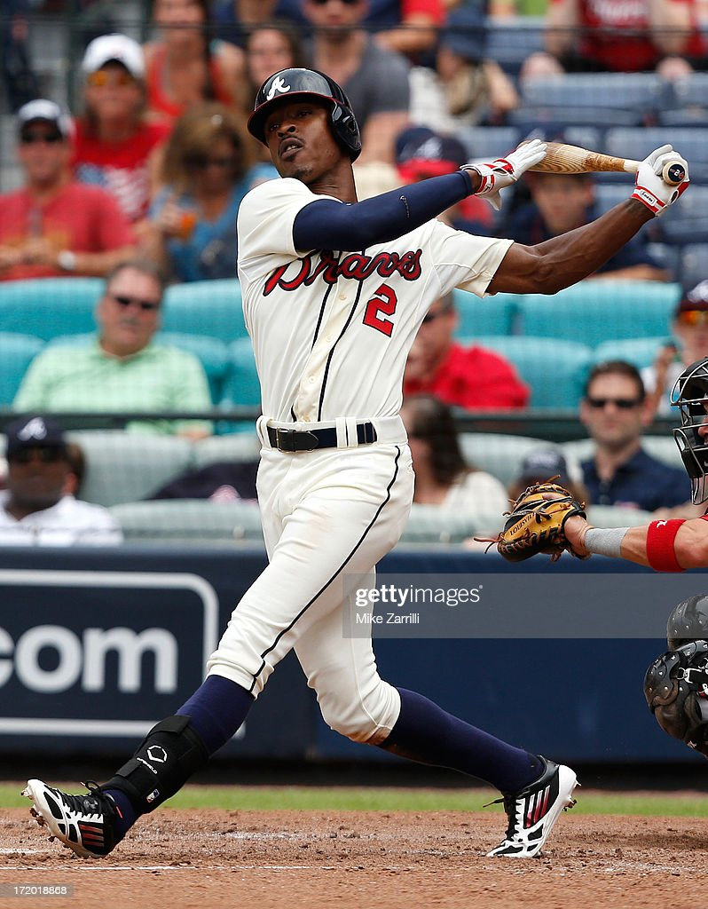 Centerfielder <a gi-track='captionPersonalityLinkClicked' href=/galleries/search?phrase=B.J.+Upton&family=editorial&specificpeople=810704 ng-click='$event.stopPropagation()'>B.J. Upton</a> #2 of the Atlanta Braves follows through on a swing during the game against the Arizona Diamondbacks at Turner Field on June 30, 2013 in Atlanta, Georgia.