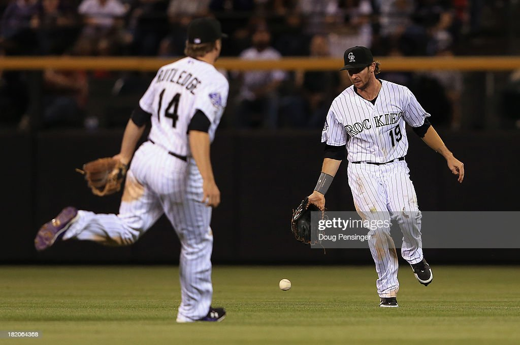 Centerfielder Charlie Blackmon #19 of the Colorado Rockies and second baseman <a gi-track='captionPersonalityLinkClicked' href=/galleries/search?phrase=Josh+Rutledge&family=editorial&specificpeople=9541486 ng-click='$event.stopPropagation()'>Josh Rutledge</a> #14 of the Colorado Rockies watch a pop fly drop between them for a base hit against the Boston Red Sox at Coors Field on September 25, 2013 in Denver, Colorado.