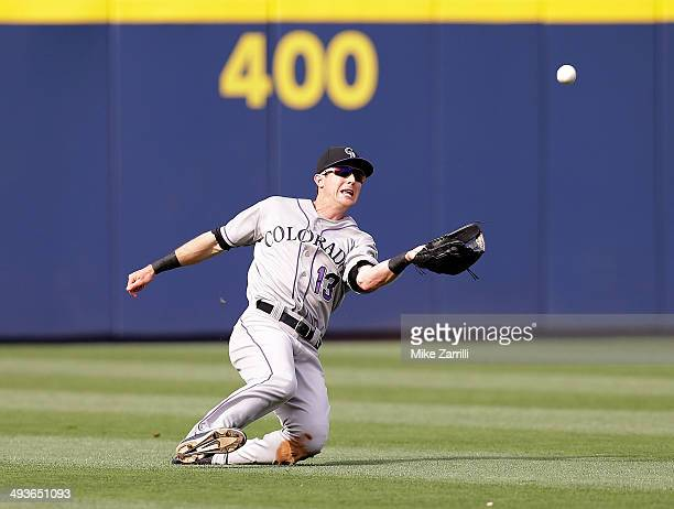 Centerfielder Drew Stubbs of the Colorado Rockies makes a diving catch in the fifth inning of the game against the Atlanta Braves at Turner Field on...