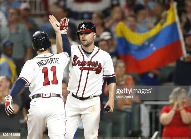 Centerfielder Ender Inciarte of the Atlanta Braves is congratulated by pitcher Jaime Garcia after Inciarte hit a 2run home run in the fifth inning...