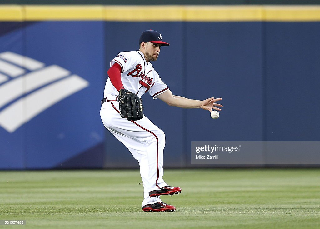 Centerfielder Ender Inciarte #11 of the Atlanta Braves tries to bare hand a ground ball in the fourth inning during the game against the Milwaukee Brewers at Turner Field on May 26, 2016 in Atlanta, Georgia.