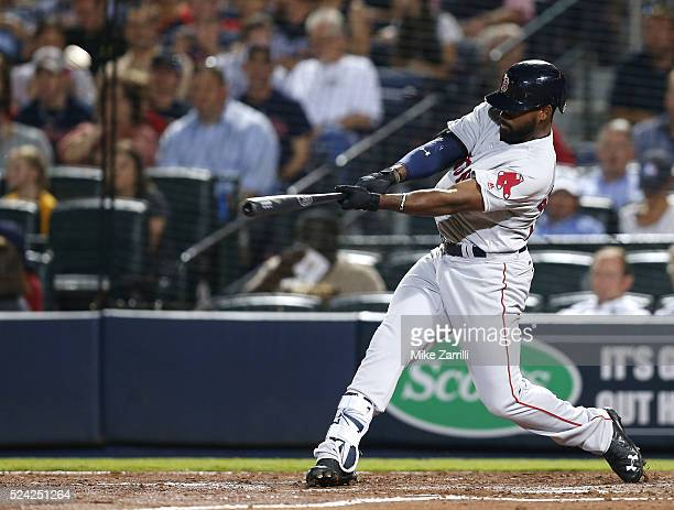 Centerfielder Jackie Bradley Jr #25 of the Boston Red Sox hits a solo home run in the seventh inning during the game against the Atlanta Braves at...