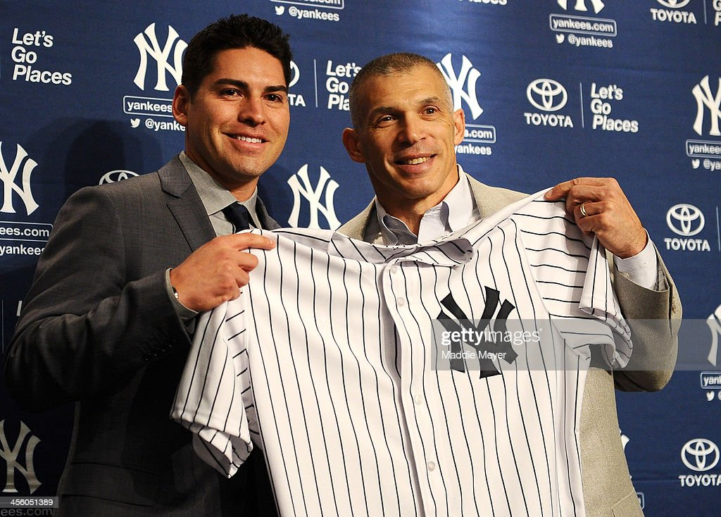 Centerfielder <a gi-track='captionPersonalityLinkClicked' href=/galleries/search?phrase=Jacoby+Ellsbury&family=editorial&specificpeople=4172583 ng-click='$event.stopPropagation()'>Jacoby Ellsbury</a> and New York Yankees Manager <a gi-track='captionPersonalityLinkClicked' href=/galleries/search?phrase=Joe+Girardi&family=editorial&specificpeople=208659 ng-click='$event.stopPropagation()'>Joe Girardi</a> stand for a photo during Ellsbury's introductory press conference at Yankee Stadium on December 13, 2013 in the Bronx borough of New York City.