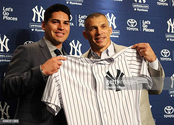 Centerfielder Jacoby Ellsbury and New York Yankees Manager Joe Girardi stand for a photo during Ellsbury's introductory press conference at Yankee...