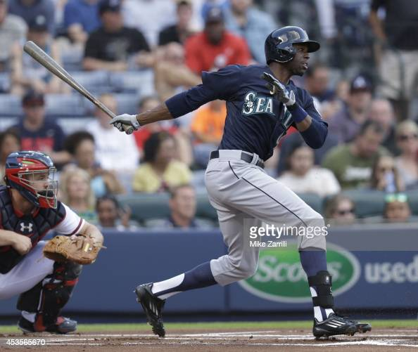 Centerfielder James Jones of the Seattle Mariners follows through on a swing during the game against the Atlanta Braves at Turner Field on June 3...