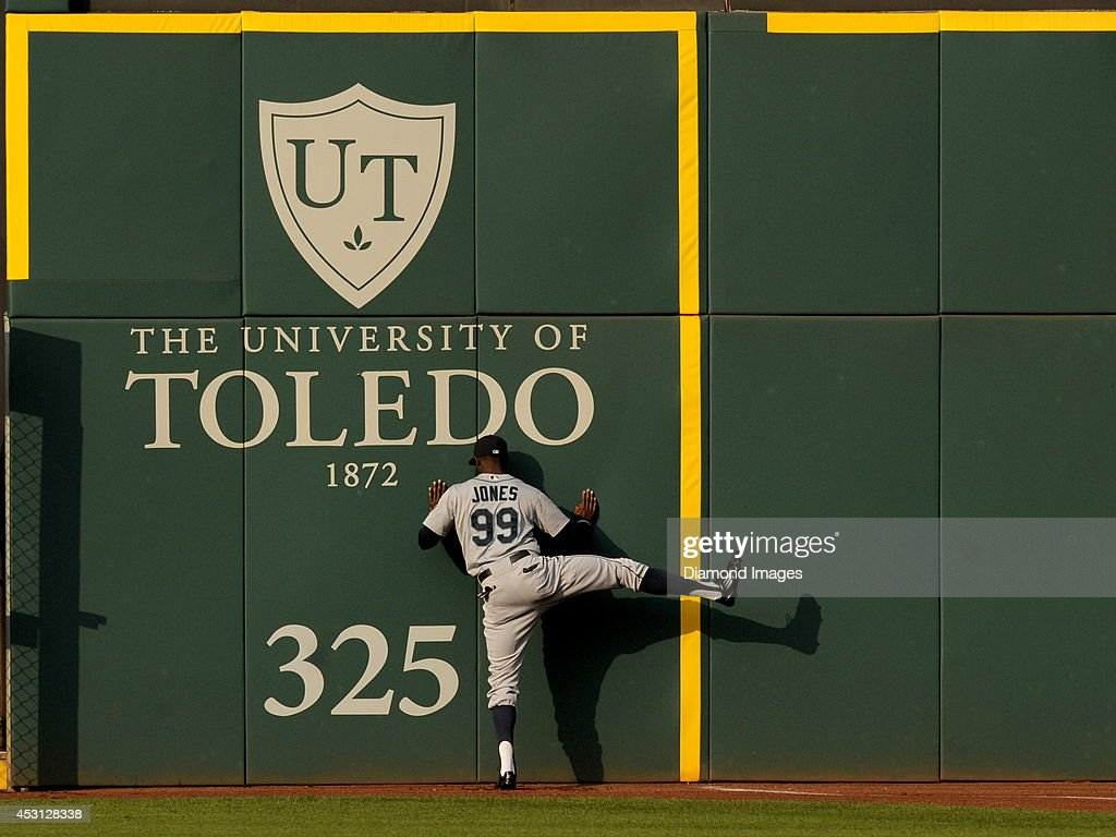 Centerfielder James Jones of the Seattle Mariners stretches by the right field wall prior to a game against the Cleveland Indians on July 30 2014 at...