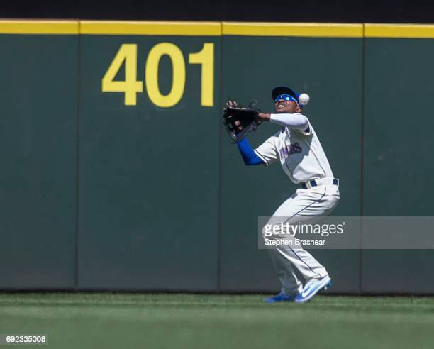 Centerfielder Jarrod Dyson of the Seattle Mariners cannot make a play on a ball hit by Daniel Robertson of the Tampa Bay Rays game at Safeco Field on...