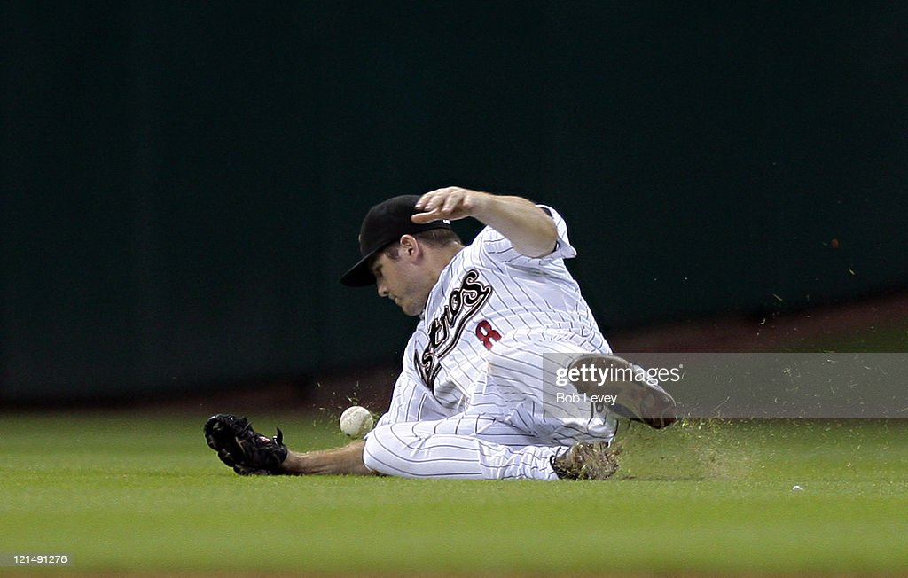 Centerfielder J.B. Shuck #8 of the Houston Astros misses on a diving attempt on a short fly ball by Nate Schierholtz #12 of the San Francisco Giants in the sixth inning at Minute Maid Park on August 19, 2011 in Houston, Texas.