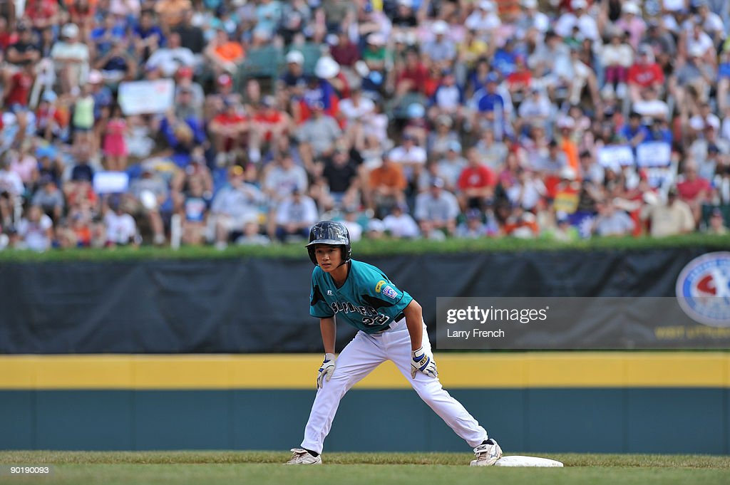 Centerfielder Kuan Sheng Huang #22 of Asia Pacific (Taoyuan, Taiwan) leans off second base during the game against California (Chula Vista) in the little league world series final at Lamade Stadium on August 30, 2009 in Williamsport, Pennsylvania.