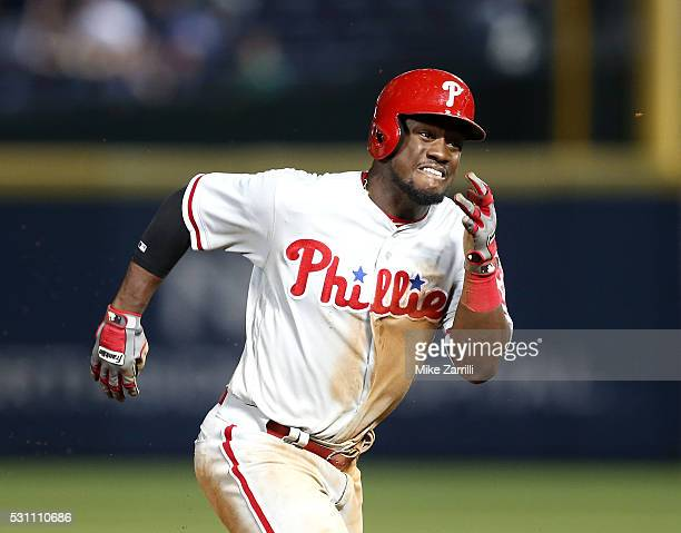 Centerfielder Odubel Herrera of the Philadelphia Phillies runs to third for a triple in the tenth inning during the game against the Atlanta Braves...