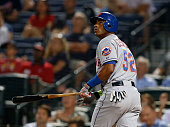 Centerfielder Yoenis Cespedes of the New York Mets hits a 2run home run in the eighth inning during the game against the Atlanta Braves at Turner...