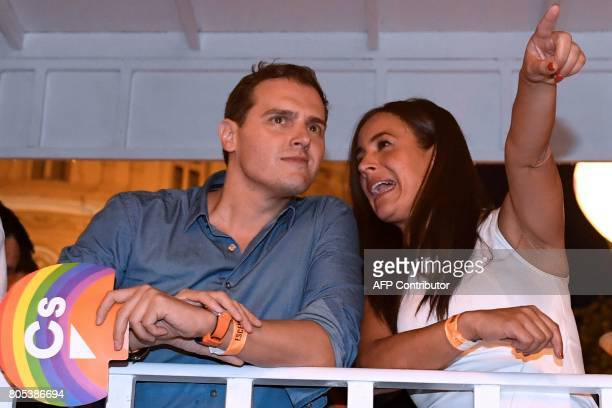 Centerright party Ciudadanos leader Albert Rivera and Ciudadanos political party member Begona Villacis talk as they ride on a float during the...