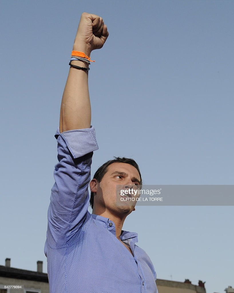 Center-right party Ciudadanos leader and party candidate, Albert Rivera, gestures during the partys final campaign meeting on Isabel II Square in Madrid on June 24, 2016 ahead of the June 26 general election. Spain votes again on June 26, six months after an inconclusive election which saw parties unable to agree on a coalition government. TORRE