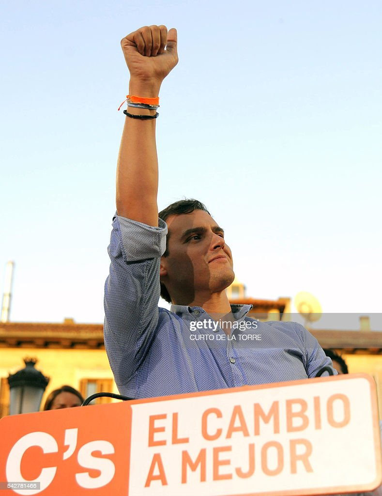 Center-right party Ciudadanos leader and party candidate, Albert Rivera, gestures during the partys final campaign meeting on Isabel II Square in Madrid on June 24, 2016 ahead of the June 26 general election. Spain votes again on June 26, six months after an inconclusive election which saw parties unable to agree on a coalition government. Here are the key numbers of the election: TORRE