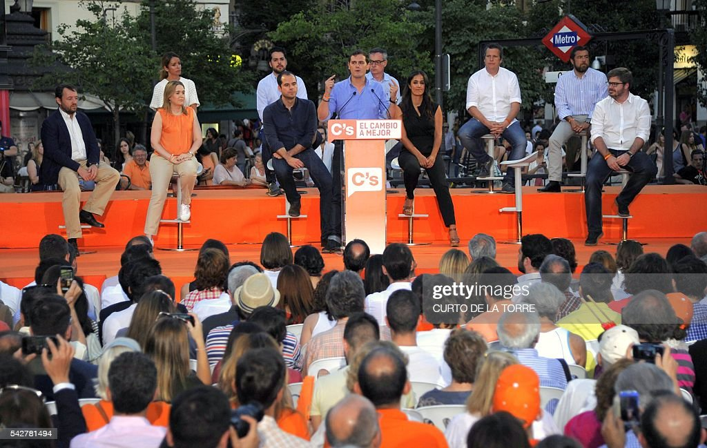Center-right party Ciudadanos leader and party candidate, Albert Rivera, (C) speaks during the partys final campaign meeting on Isabel II Square in Madrid on June 24, 2016 ahead of the June 26 general election. Spain votes again on June 26, six months after an inconclusive election which saw parties unable to agree on a coalition government. Here are the key numbers of the election: TORRE