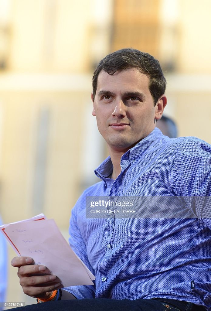 Center-right party Ciudadanos leader and party candidate, Albert Rivera, sits during the partys final campaign meeting on Isabel II Square in Madrid on June 24, 2016 ahead of the June 26 general election. Spain votes again on June 26, six months after an inconclusive election which saw parties unable to agree on a coalition government. TORRE