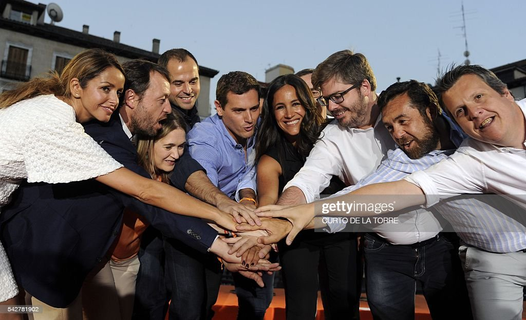Center-right party Ciudadanos leader and party candidate, Albert Rivera, (C) celebrates with party members after the partys final campaign meeting on Isabel II Square in Madrid on June 24, 2016 ahead of the June 26 general election. Spain votes again on June 26, six months after an inconclusive election which saw parties unable to agree on a coalition government. TORRE