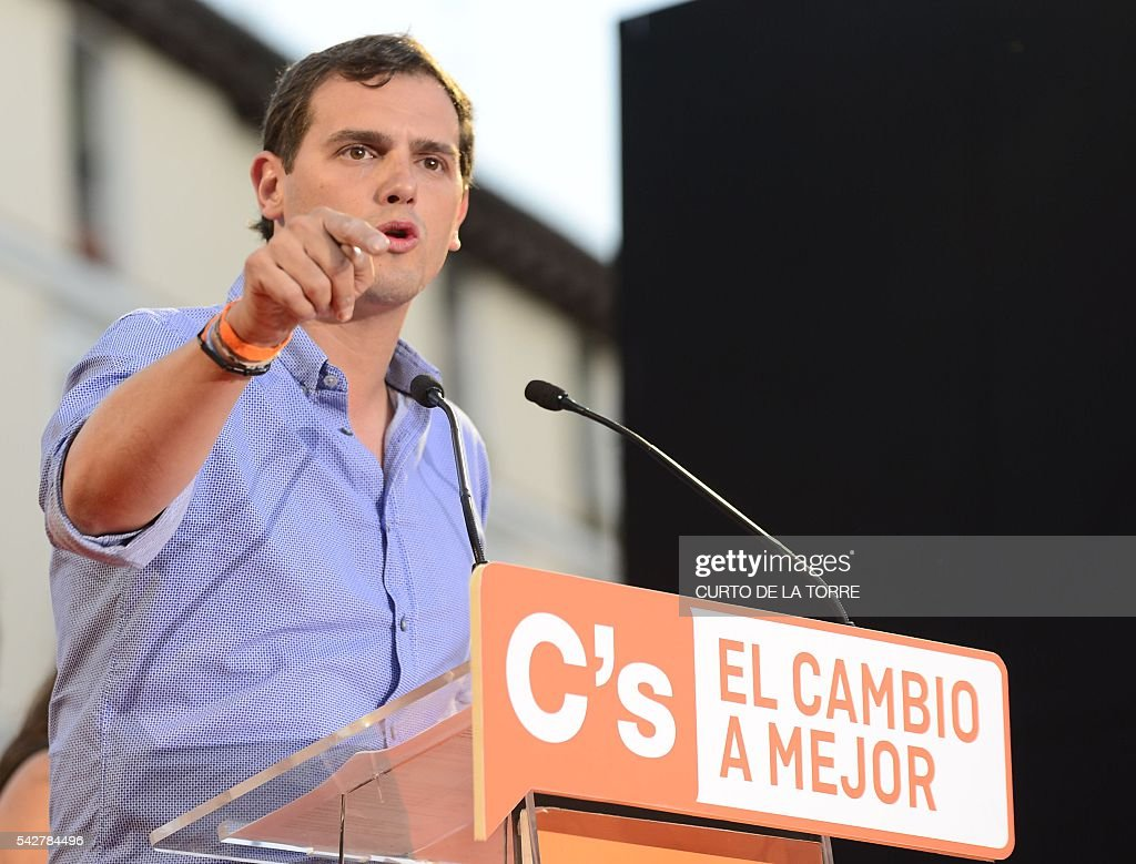 Center-right party Ciudadanos leader and party candidate, Albert Rivera, gestures as he speaks during the partys final campaign meeting on Isabel II Square in Madrid on June 24, 2016 ahead of the June 26 general election. Spain votes again on June 26, six months after an inconclusive election which saw parties unable to agree on a coalition government. TORRE