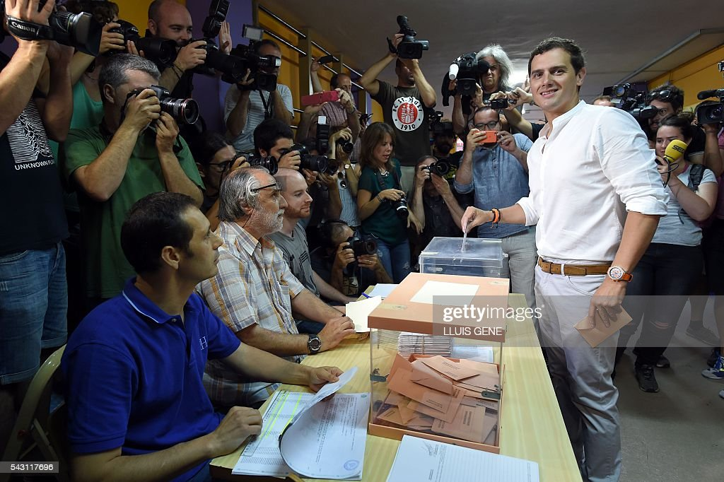 Center-right party Ciudadanos leader and party candidate, Albert Rivera, poses before casting his vote in Spains general election at a polling station in Hospitalet, near Barcelona on June 26, 2016. Spain votes today, six months after an inconclusive election which saw parties unable to agree on a coalition government. GENE