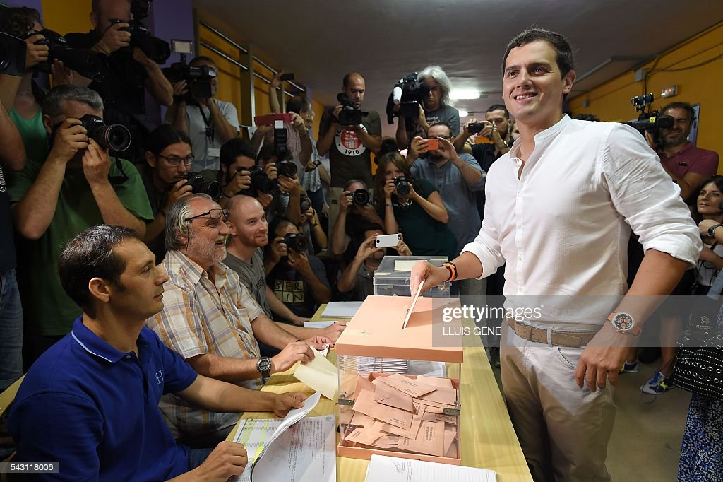 Center-right party Ciudadanos leader and party candidate, Albert Rivera, poses as he casts his ballot in Spains general election at a polling station in Hospitalet, near Barcelona on June 26, 2016. Spain votes today, six months after an inconclusive election which saw parties unable to agree on a coalition government. GENE