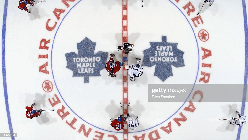 Centers Mats Sundin of the Toronto Maple Leafs and Chad Kileger of the Montreal Canadiens face off during the NHL game on October 2 2002 at the Air...