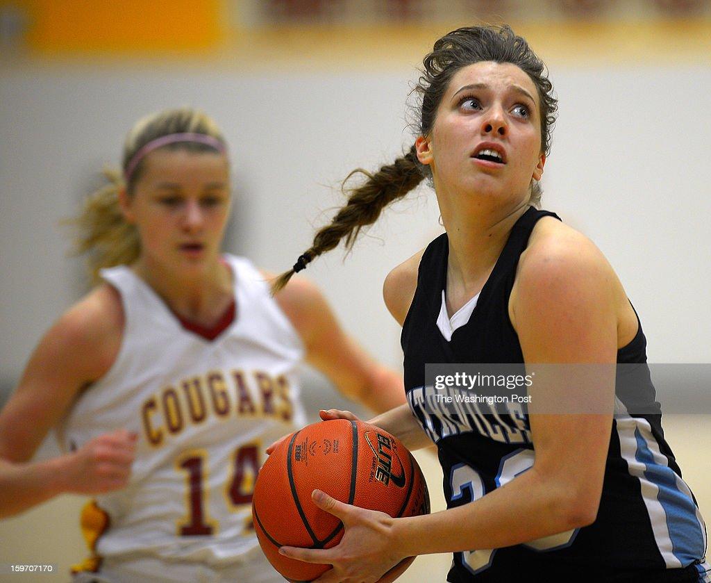 Centerville's Ailyn Kelly, right, drives hard to the basket past Oakton's Karlie Cronin as Oakton defeats Centerville in girls basketball at Oakton High School in Oakton VA, January 18, 2012 .