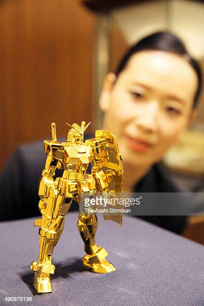 A 125 centimetre pure gold statue of the 'Mobile Suit Gundam' is displayed at Ginza Tanaka Shinsaibashi on October 1 2015 in Osaka Japan