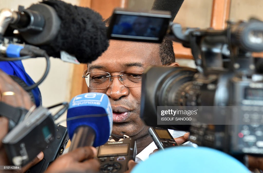 Centrafrican Democratic Unity party (Rassemblement Democratique centrafricain - RDC) second round presidential candidate Anicet Georges Dologuele speaks to journalists after casting his ballot for delayed legislative elections and a presidential run-off, at a polling station in Bangui, on February 14, 2016. The Central African Republic holds delayed presidential and parliamentary polls on February 14, with voters desperate to usher in peace after the country's worst sectarian violence since independence in 1960. / AFP / ISSOUF SANOGO