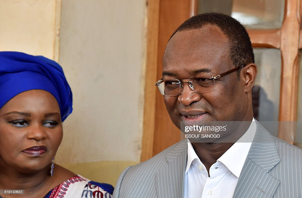 Centrafrican Democratic Unity party (Rassemblement Democratique centrafricain - RDC) second round presidential candidate Anicet Georges Dologuele speaks to journalists, next to his wife, after casting his ballot for delayed legislative elections and a presidential run-off, at a polling station in Bangui, on February 14, 2016. The Central African Republic holds delayed presidential and parliamentary polls on February 14, with voters desperate to usher in peace after the country's worst sectarian violence since independence in 1960. / AFP / ISSOUF SANOGO