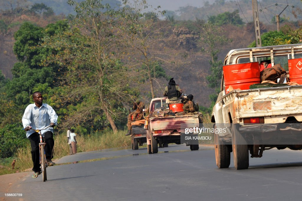 A Centrafrican military convoy drives on a road going to Sibut, 160 km north of Bangui, on December 29, 2012. Sibut was seized by the rebel coalition Seleka on December 29. Authorities in the Central African Republic capital Bangui have imposed today a nighttime curfew as fighters from the rebel coalition move closer to the city, according to a government decree.