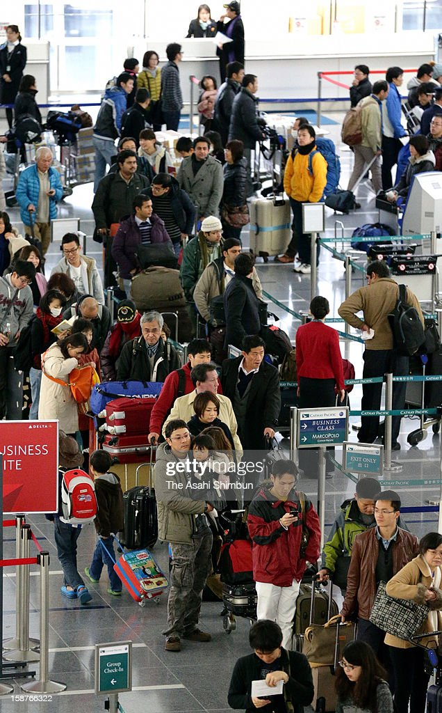 Centrair Airport, or Central Japan International Airport is packed with holiday travellers on December 28, 2012 in Tokoname, Aichi, Japan. Horiday travel rush starts today, peaks December 29.