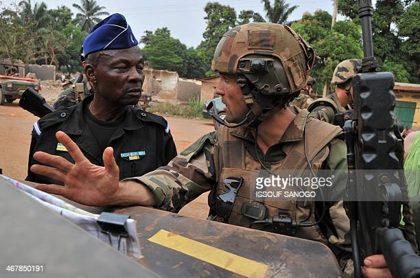 A Central African gendarmerie officer and a French soldier of the Sangaris military operation discuss before patrolling together for the first time...