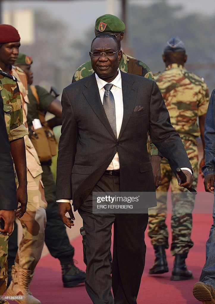 Central African president <a gi-track='captionPersonalityLinkClicked' href=/galleries/search?phrase=Michel+Djotodia&family=editorial&specificpeople=10107290 ng-click='$event.stopPropagation()'>Michel Djotodia</a> arrives at Mpoko Bangui airport on his way to N'Djamena to attend a summit on the unrest in Centrafrica on January 8, 2014. African leaders are to meet in Chad Thursday to discuss the future of Central African Republic President <a gi-track='captionPersonalityLinkClicked' href=/galleries/search?phrase=Michel+Djotodia&family=editorial&specificpeople=10107290 ng-click='$event.stopPropagation()'>Michel Djotodia</a>, in a bid to end the sectarian violence ripping the country apart. No official agenda has been drawn up for the summit called by Chadian President Idriss Deby Itno of ten countries making up the Economic Community of Central African States (CEEAC). AFP PHOTO / ERIC FEFERBERG