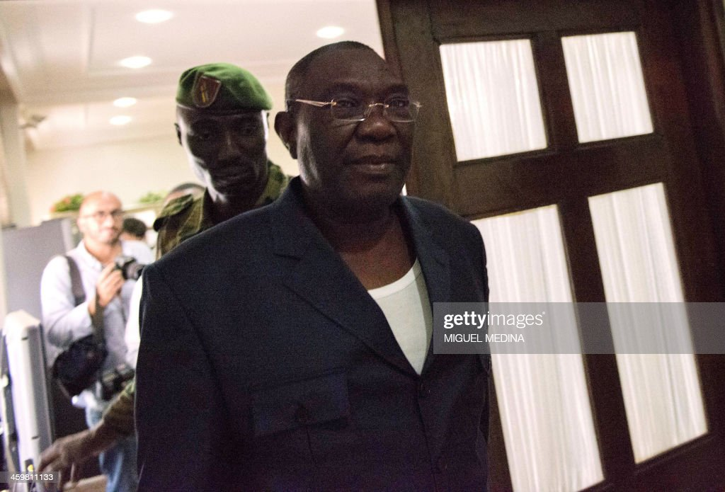 Central African president <a gi-track='captionPersonalityLinkClicked' href=/galleries/search?phrase=Michel+Djotodia&family=editorial&specificpeople=10107290 ng-click='$event.stopPropagation()'>Michel Djotodia</a> leaves after giving a statement to the press at his residence in Bangui on December 31, 2013. Christian militiamen attacked a Central African army base in the capital Bangui on December 31, 2013, as French and African soldiers struggled to contain sectarian violence. Vigilantes attacked a military position at the PK-11 crossroads on the northern outskirts of Bangui, General Mahamat Tahir Zaroga told AFP. AFP PHOTO/MIGUEL MEDINA